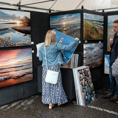 People look at canvas photographic prints of Michigan