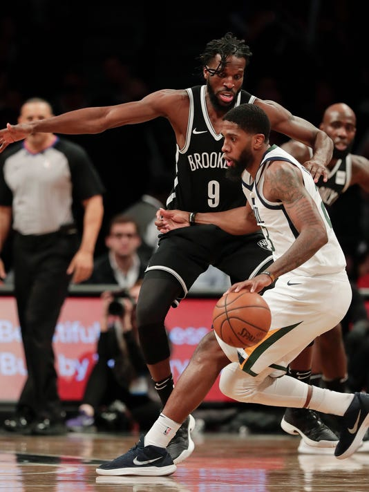 Utah Jazz forward Royce O'Neale (23) drives against Brooklyn Nets forward DeMarre Carroll (9) during the second quarter of an NBA basketball game, Friday, Nov. 17, 2017, in New York. (AP Photo/Julie Jacobson)