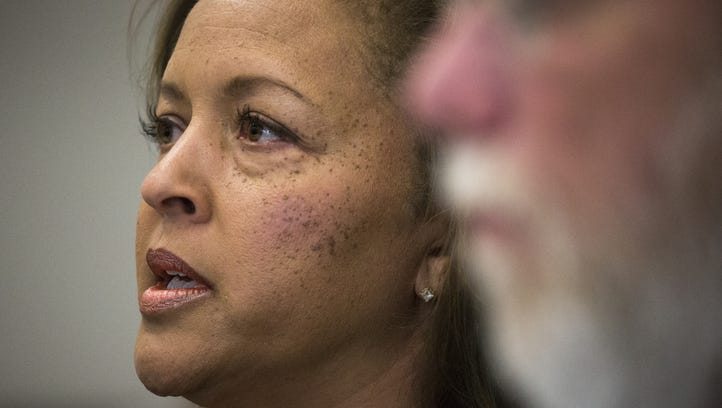 Connie Jones answers questions during a press conference