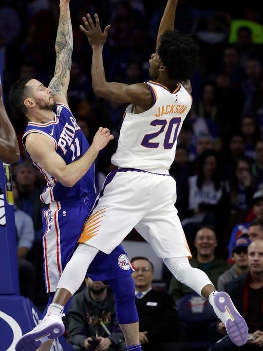 Phoenix Suns' Josh Jackson, right, goes up to shoot against Philadelphia 76ers' JJ Redick during the first half of an NBA basketball game, Monday, Dec. 4, 2017, in Philadelphia. (AP Photo/Matt Slocum)