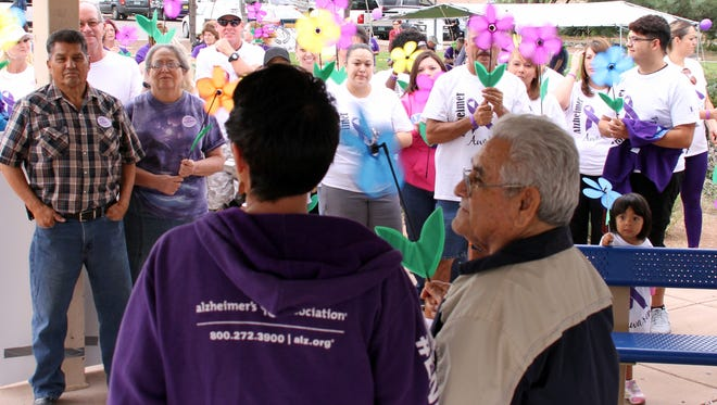 Tony Pedraza Sr., right, was introduced during last Saturday's Walk to End Alzheimer's held at Voiers Park in Deming. The walk helped raise money for the research of Alzheimer's Disease and for those who care for people with Alzheimer's. The event was sponsored by the Alzheimer's Association of New Mexico and walks were held in six New Mexico cities, including Deming. Close to 200 people took part in the walk.