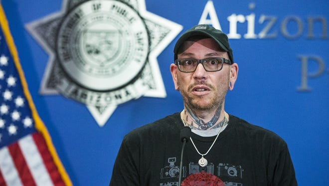 Thomas Yoxall, 43, the Good Samaritan who stopped to help Arizona Public Safety Trooper Ed Andersson and ended up shooting a suspect who was attacking the officer, meets the media for the first time, Tuesday, January 24, 2016, in Phoenix.