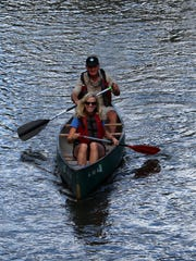 State Sen. Janet Petersen paddles down Beaver Creek with her former Iowa House colleague and DNR Director Chuck Gipp.