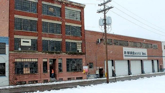 The former R-Wireworks building on Baldwin Street in Elmira is among 100 properties up for sale during Chemung County's annual property tax auction Wednesday.