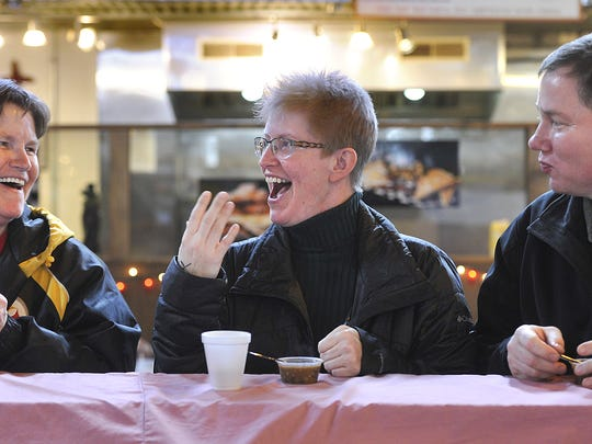 """With her sister Deb Fuhrman, left, looking on, Melissa Fuhrman from Hanover fans her mouth after taking a sampling of chili during the chili festival at Central Market on Saturday, Jan. 28, 2017. Mudhook Brewing Company will hold """"Flavors of Central Market"""" - an event featuring beer and food pairings - on April 15."""