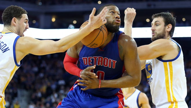 Detroit Pistons forward Greg Monroe drives against the Golden State Warriors at Oracle Arena.