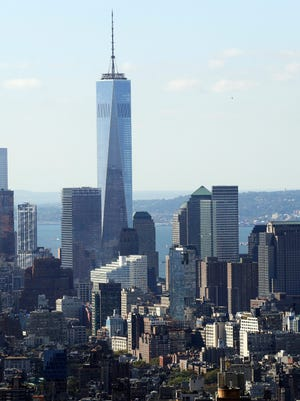 One World Trade Center and the lower Manhattan skyline are seen from the Rainbow Room, New York City's landmark restaurant atop 30 Rockefeller Plaza, Sunday, Oct. 5, 2014. The Rainbow Room has returned to its historic perch over New York's skyline after a five-year absence, again offering its diners sweeping views of the city and beyond. (AP Photo/Mark Lennihan)