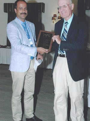 Dr. Jyotí Tripathy of Chennai, India (left), president of the Association of Third World Studies, presents the ATWS award for Outstanding Leadership to Dr. William D. Pederson of LSUS during the 33rd annual ATWS conference held in Quito, Ecuador.