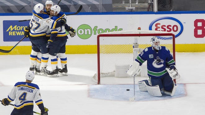 Vancouver Canucks goaltender Jacob Markstrom (25) pauses after giving up a goal as St. Louis Blues' Ryan O'Reilly (90), David Perron (57) and Jaden Schwartz (17) celebrate during the second period in Game 4 of a first-round playoff series Monday in Edmonton, Alberta.
