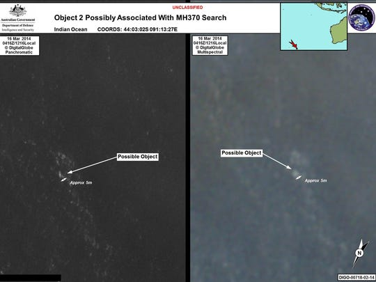 """This combo of handout images taken on March 16, 2014 and released on March 20, 2014 by the Australian Government's Department of Defence via the Australian Maritime Safety Authority show satelite images of objects in the Indian Ocean which may be from missing Malaysia Airlines flight MH370 which disappeared en route to Beijing early on March 8.  Australia said on March 20 that the two objects -- the largest estimated at 24 metres (79 feet) long -- spotted in the Indian Ocean were the """"best lead we have"""" in the search for the missing Malaysian passenger jet."""