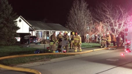 Fire crews battled a house fire on Longmeadow Lane in Fort Mitchell early Friday.