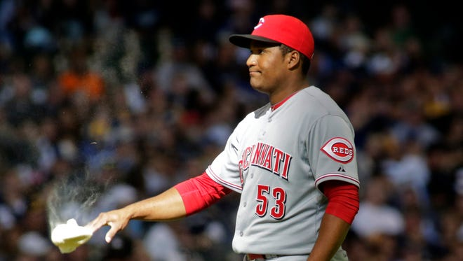 Cincinnati Reds pitcher Carlos Contreras reacts after walking in a run for the Milwaukee Brewers during the seventh inning.