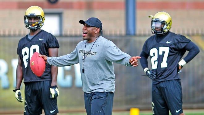 Vanderbilt Head Coach Derek Mason coaches during the first day of the training camp in Nashville, Tenn., Thursday, July 31, 2014.