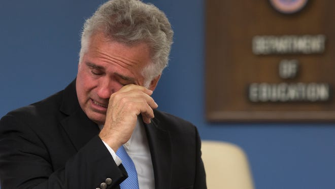 """Arizona Superintendent of Public Instruction cries after apologizing for his """"hurtful"""" blog posts during a press conference Wednesday."""