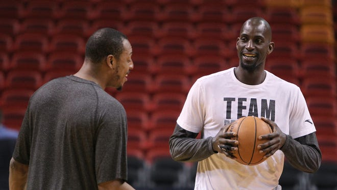 Brooklyn's Paul Pierce, left, and teammate Kevin Garnett talk during the team's basketball practice on Wednesday in Miami.