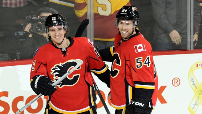 Calgary Flames centre Mikael Backlund (11) and right wing David Jones (54) celebrate Backlund's goal against the Phoenix Coyotes during the second period at Scotiabank Saddledome.