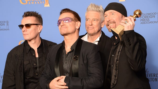 """Larry Mullen Jr., Bono, Adam Clayton and The Edge of U2 won the Golden Globe for best original song  for """"Ordinary Love"""" from """"Mandela: Long Walk to Freedom."""""""