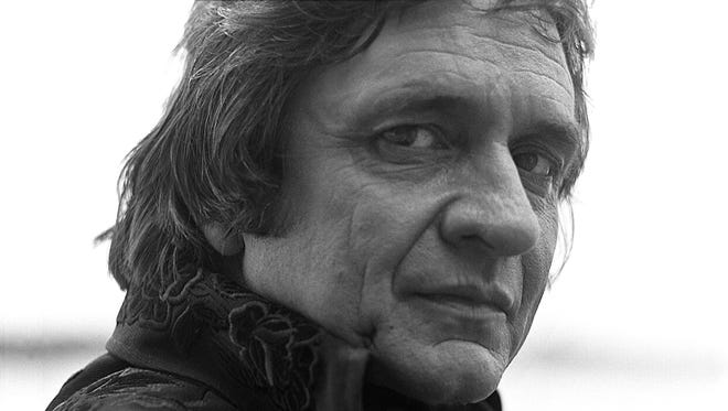 """""""Out Among the Stars,"""" out March 25, 2014, features 12 previously unreleased recordings Johnny Cash made during the early 1980s."""