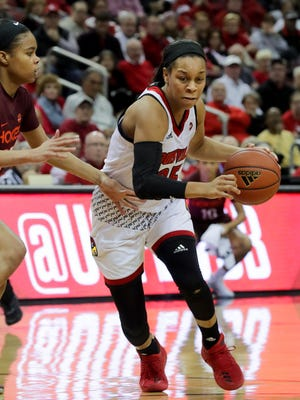 Louisville's Asia Durr drives for the basket.