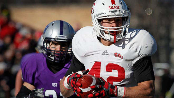 St. John's University tight end Nick Simon pulls in a pass over St. Thomas defensive back Bennett Celichowski and takes it in to score during the first half Saturday, Nov. 28, at O'Shaughnessy Stadium in St. Paul.