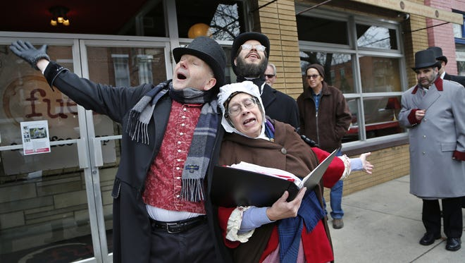 """Dickens of a Christmas is back. Last year, Bob Cratchit, played by Kevin Doerr, Mary Hogarth, played by Peg Black, and a caroler played by Daniel Carr sign in a scene from Charles Dickens' """"A Christmas Carol."""" Dickens of a Christmas is back. Last year, Bob Cratchit, played by Kevin Doerr, Mary Hogarth, played by Peg Black, and a caroler played by Daniel Carr sign in a scene from Charles Dickens' """"A Christmas Carol."""""""