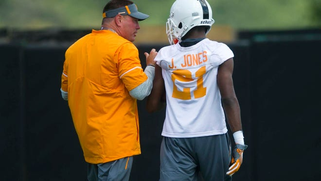 Butch Jones speaks with wide receiver Jacquez Jones at the first University of Tennessee fall football practice of the year at Anderson Training Facility in Knoxville, Tenn. on Saturday, July 29, 2017.