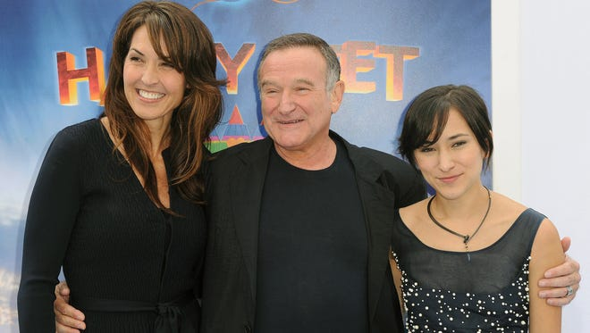 Robin Williams with wife Susan, and his daughter Zelda, in November 2011.