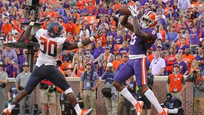 Clemson wide receiver Deon Cain (8) catches a touchdown ahead of Syracuse linebacker Parris Bennett (30) during the third quarter on Saturday at Memorial Stadium.