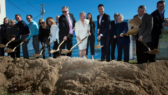 The University of West Florida administrators, city officials and other dignitaries break ground the university's new interpretative history project in downtown Pensacola. The new project will include turning the parking lot in the center into a green space.