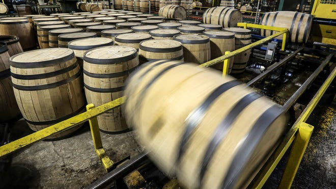 A bourbon barrel rolls down the line at the Brown-Forman cooperage.February 7, 2017