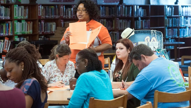 Bellview Middle School Principal Melia Adams holds an orientation for first-year teachers in the school's library on Tuesday, July 25, 2017.