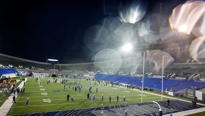University of Memphis takes the field for warmups as heavy rains and winds that pour down inside the Liberty Bowl Memorial Stadium before the Tigers first football game of the season against Louisiana-Monroe, Thursday evening.