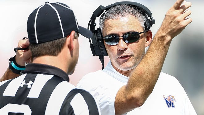 University of Memphis head coach Mike Norvell (right) during first quarter action against UCLA at The Liberty Bowl Memorial Stadium in Memphis, Tennessee., Friday, September 16, 2017.