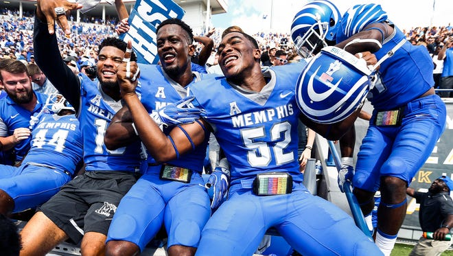 University of Memphis players celebrate a 48-45 victory over national ranked UCLA at The Liberty Bowl Memorial Stadium in Memphis, Tennessee., Friday, September 16, 2017.