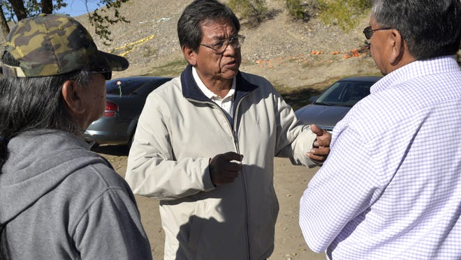 In this Nov. 2014 file photo, Navajo Nation presidential candidate Russell Begaye, center, speaks with a group outside of the Shiprock Chapter House in Shiprock, N.M.