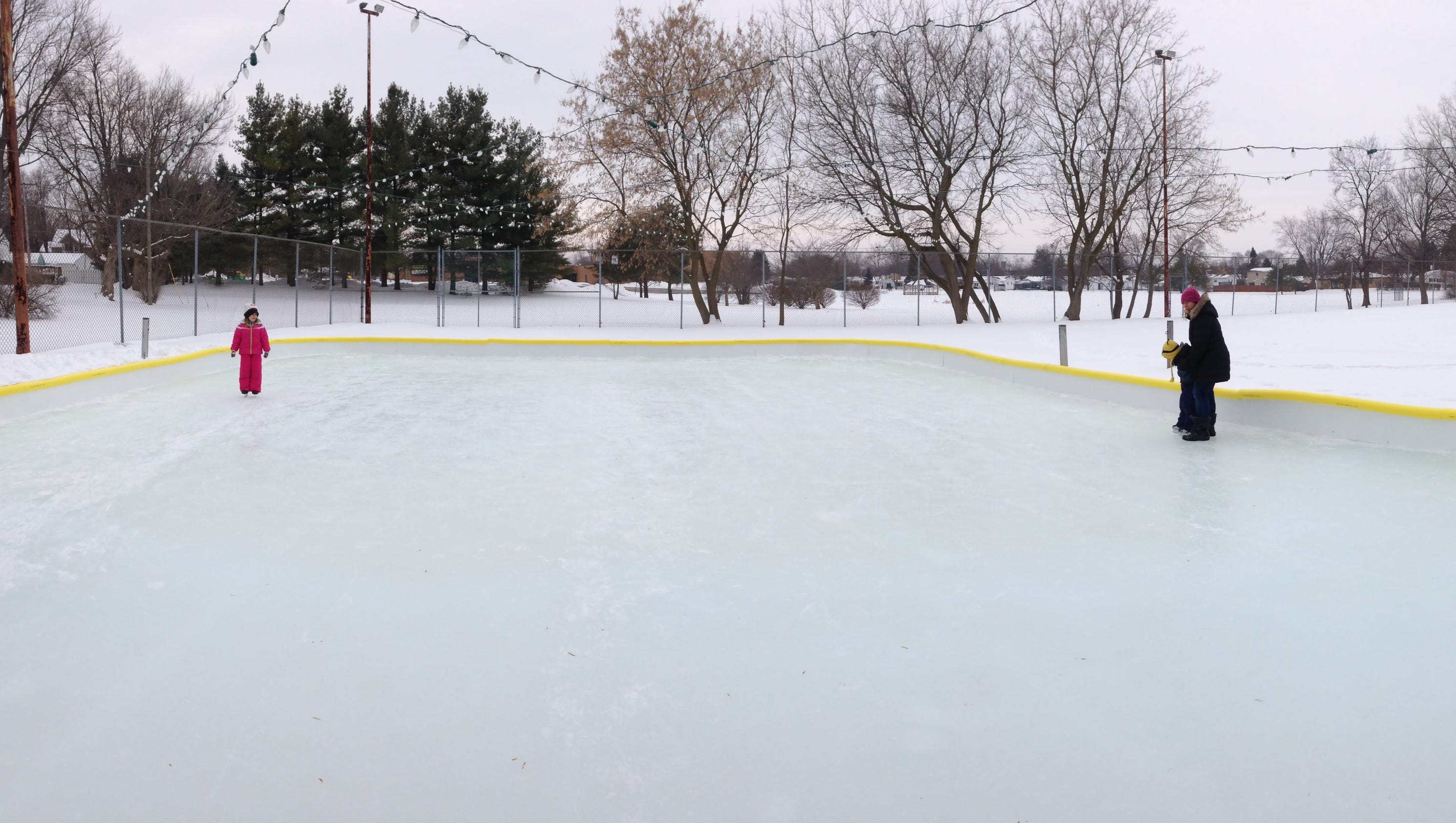 volunteers help build east lansing u0027s outdoor ice rink