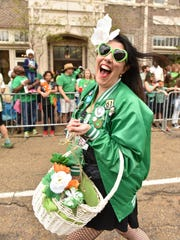 Lindsay Thomas Dowdle of the Green Ladies krewe marches in the 2017 Hal's St. Paddy's Parade in downtown Jackson. This year's parade and festivities are set for Saturday, March 23.