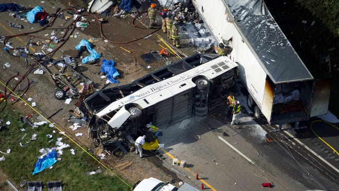In this aerial photo, emergency workers respond to a crash involving a passenger bus, a tractor-trailer and an SUV near Dandridge, Tenn., on  Oct. 2.