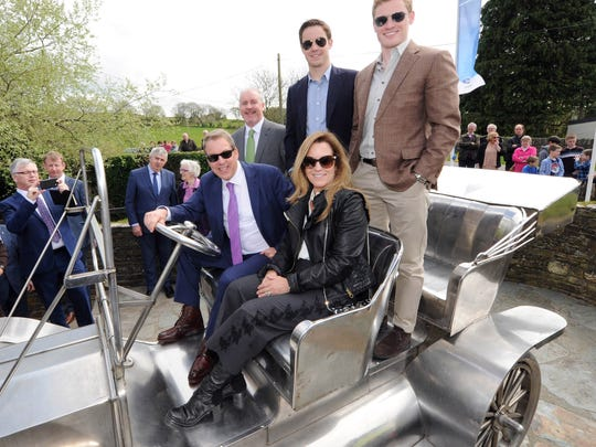 The Ford family, Bill Ford Jr. with his wife Lisa and sons Nick and Will with a Model T replica in the village of Ballinascarthy, County Cork, Ireland. Ballinascarthy is the birthplace of William Ford, the father of Henry Ford.
