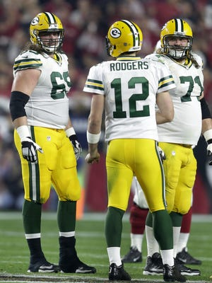 Green Bay Packers left tackle David Bakhtiari, quarterback Aaron Rodgers and left guard Josh Sitton in the second quarter against the Arizona Cardinals