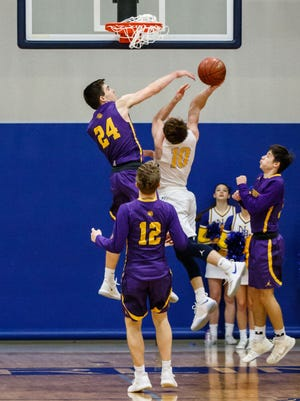 New Berlin West senior Joe Robey (10) scores the go-ahead basket and gets the foul in the final seconds of overtime at home against New Berlin Eisenhower on Tuesday, Jan. 23, 2018.
