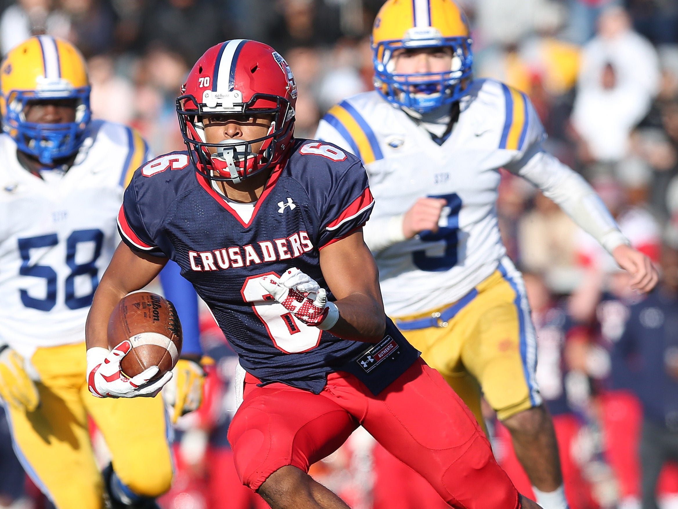 Stepinac's Terrell Morrison (6) finds some room in the Saint Peter's defense as he runs for a 3rd quarter touchdown during the NYCHSFL semifinals at Archbishop Stepinac High School in White Plains Nov 15, 2015. Stepinac won the game 49-7.