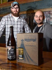 Hi-Wire Brewing co-owners Chris Frosaker, left, and
