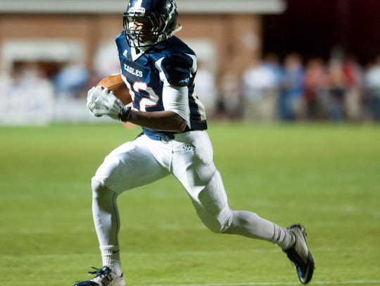 Montgomery Academy's Keefe White carries against Trinity