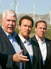 From left, Fred Noble of Wintec Energy, Arnold Schwarzenegger, and Palm Springs mayor Steve Pougnet speak to the media about green energy on a Wintec windmill farm Tuesday, March 2nd, 2010.