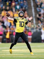 Oregon Ducks quarterback Justin Herbert (10) throws during the third quarter against the Arizona State Sun Devils at Autzen Stadium.