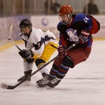 Great Falls Americans' Sean Morris (24) controls the puck at the Casey Cup Tournament last year at the IcePlex.