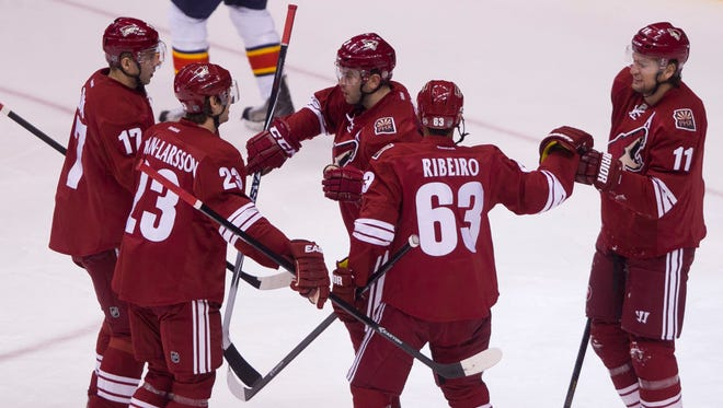 The Coyotes celebrate a Radim Vrbata goal against the Panthers in the first period at Jobing.com Arena on Thursday, March 20, 2014 in Glendale, Az.