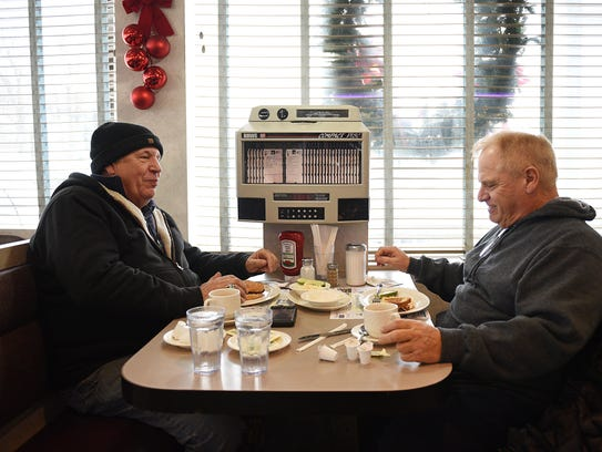Nick Del Geurcio from Cedar Grove and Tom Scorso from Belleville brave the storm for a bite at North Arlington Diner on Thursday.
