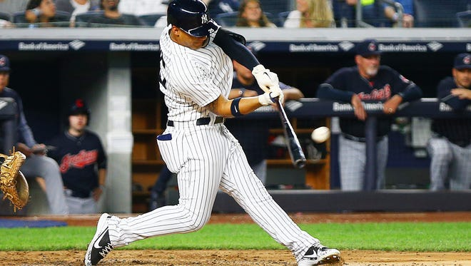 New York Yankees second baseman Gleyber Torres (25) hits a three run home run against the Cleveland Indians during the fourth inning at Yankee Stadium.